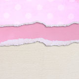 Pink torn paper over textured canvas background Stock Photos