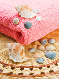 Pink towel. A sea shells lying on the white towel Royalty Free Stock Photos