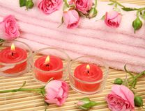 Pink towel and candles Royalty Free Stock Image