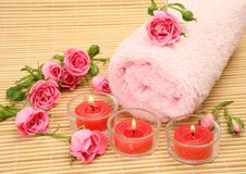Pink towel and candles Stock Image