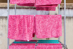 Pink towel on clothesline in sunny day Royalty Free Stock Photo