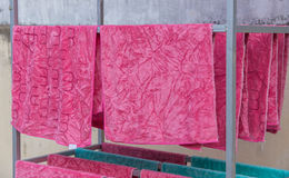 Pink towel on clothesline in sunny day Stock Photos