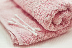 Pink towel and ear picks Stock Photography