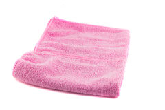 Pink towel folded in the shape of a square. On a white background Royalty Free Stock Images