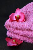 Pink towel and pink orchids Royalty Free Stock Photos