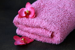 Pink towel and pink orchids Royalty Free Stock Images
