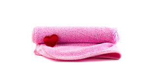 Pink towel and red heart rolled up. On a white background Royalty Free Stock Images