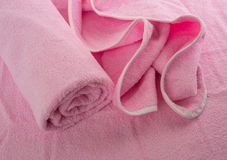 Pink towel. Rolled towel and lie next to the crumpled towel Royalty Free Stock Photo