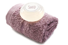 Pink towel with soap Stock Photos