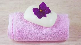 Pink towel and soap with floral scent. stock photography