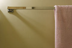 Pink towel on the wall in the bathroom Stock Images