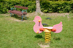 Pink toy and bench on playground Royalty Free Stock Photography