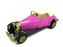 Pink toy car 2. An isolated pink and classic toy car Royalty Free Stock Photos