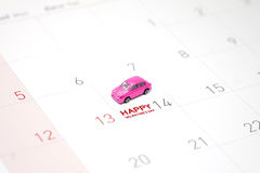 Pink toy car, a miniature park on February 14 on the calendar Stock Photo