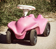 Pink toy car in outdoor Stock Image