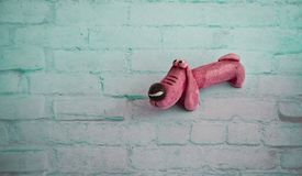 Pink toy dog on the blue background stock photo
