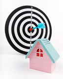 Pink toy house and dart board Royalty Free Stock Photo