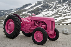 Pink tractor in Norway. Pink tractor on snowed mountain Royalty Free Stock Images