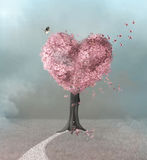 Pink tree in a fantasy meadow. Pathway to the pink heart tree Stock Image