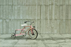 Pink tricycle Stock Photo