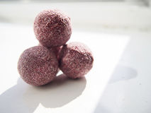 Pink Truffles. Chocolate truffles dusted with pink sugar on a white background Royalty Free Stock Photo