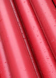 Pink tubes. Pile of long round pink wet tubes Stock Image