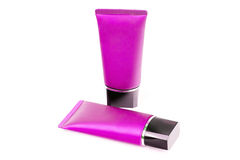 Pink tubes with cream  on white Royalty Free Stock Photo