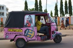 Pink tuktuk. Mombasa. Mombasa, Kenya is a vibrant and lively place. The traffic is very heavy. The market is always busy Stock Images