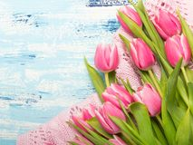 Pink tulip bouquet on blue wooden background. Copy space. Beautiful flowers Stock Photo