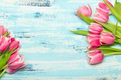 Pink tulip bouquet on blue wooden background, copy space. Beautiful flowers Stock Photo