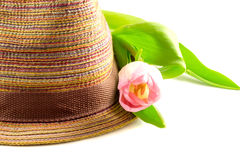 Pink tulip and colored straw hat Stock Photo