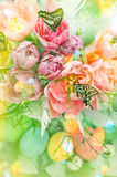 Pink tulip flowers, butterflies and colored eggs. Light leaks Royalty Free Stock Images