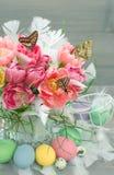 Pink tulip flowers, butterflies, easter eggs Royalty Free Stock Image