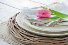 Pink tulip on rustic dinner setting Royalty Free Stock Photography