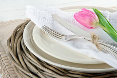 Pink tulip on rustic dinner setting Stock Photography