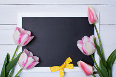 Pink Tulips with blackboard, top view, copy space. Stock Photography