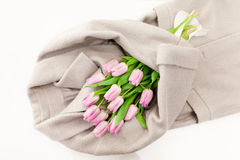 Pink tulips bouquet cover in wool coat Stock Image