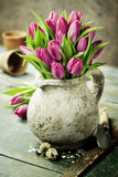 Pink tulips bouquet, easter eggs and garden tools Stock Image