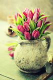 Pink tulips bouquet and garden tools Royalty Free Stock Photography
