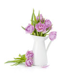 Pink tulips bouquet in pitcher Stock Images