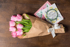Pink tulips bouquet and postcards Royalty Free Stock Images