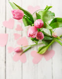 Pink tulips bouquet in vase on white wooden table Royalty Free Stock Photography