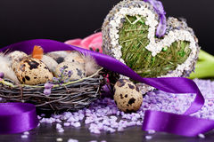 Pink tulips and brown eggs with purple ribbon easter decoration Royalty Free Stock Images