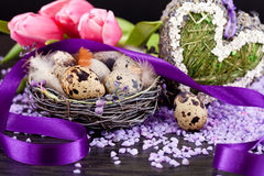 Pink tulips and brown eggs with purple ribbon easter decoration Royalty Free Stock Photos