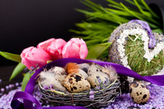 Pink tulips and brown eggs with purple ribbon easter decoration Royalty Free Stock Photo