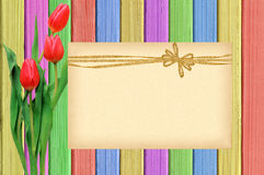 Pink tulips and card over shabby paint wooden table Stock Photos