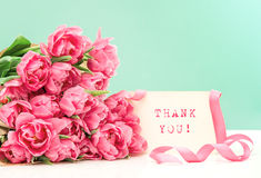 Pink tulips and card Thank You! Postcard concept. Pink tulips and card sample text Thank You! Postcard concept. Picture with oil painting effect Royalty Free Stock Image