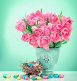 Pink tulips and chocolate Easter eggs. Flowers still life Stock Images