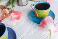 Pink tulips and coffee cups. Mother`s Day or Women`s Day Royalty Free Stock Image