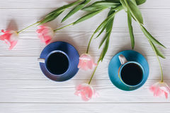Pink tulips and coffee cups. Mother`s Day or Women`s Day Royalty Free Stock Photo